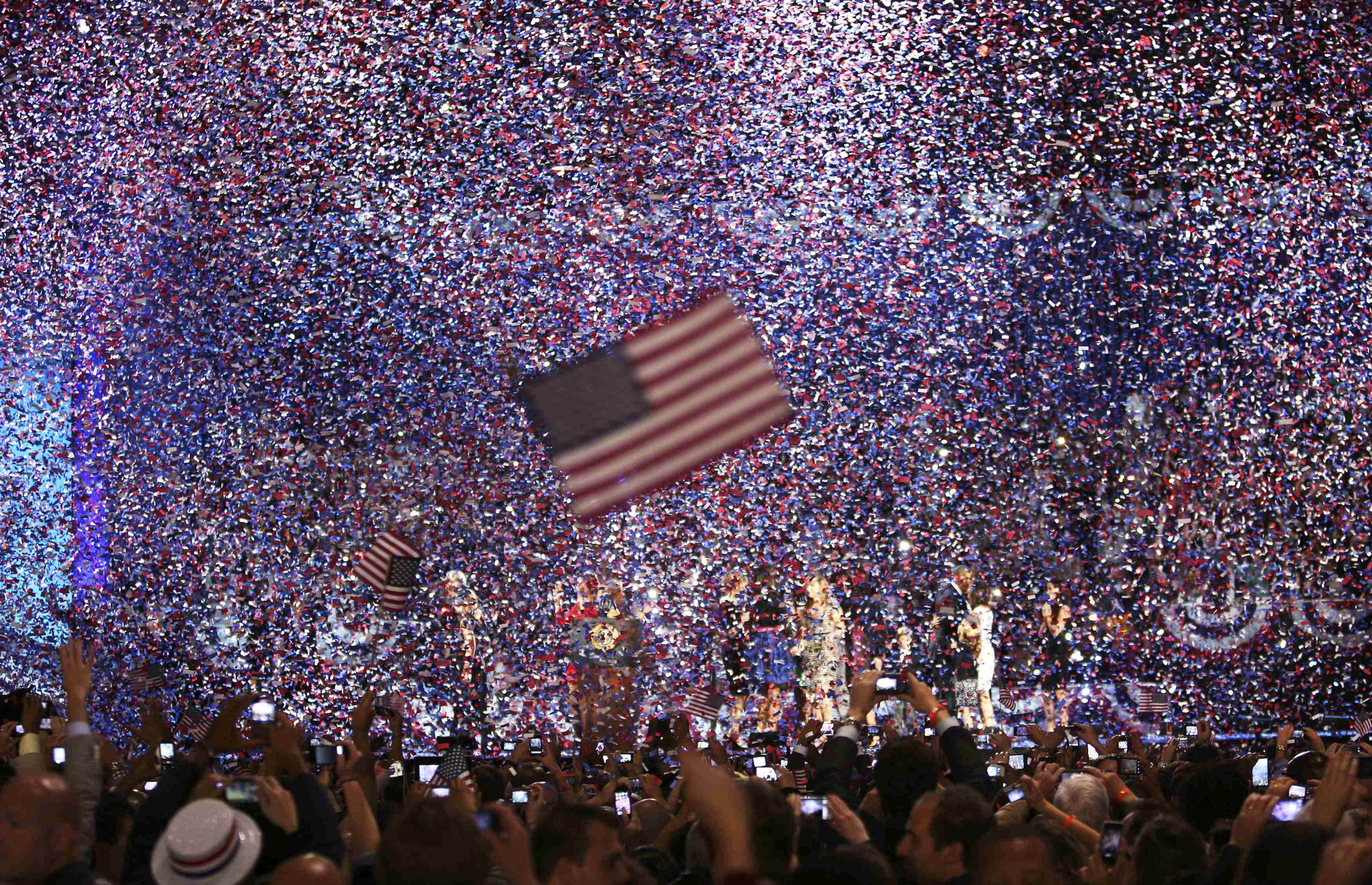 Confetti obscures the stage as U.S. President Barack Obama celebrates after winning the U.S. presidential election in Chicago