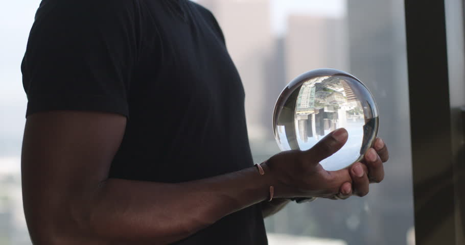 African american looking into a crystal ball
